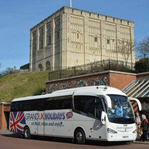 grand uk holidays coach in front of norwich castle