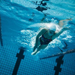 Young female swimmer training in the pool
