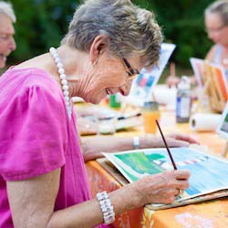 Older people enjoying a painting workshop