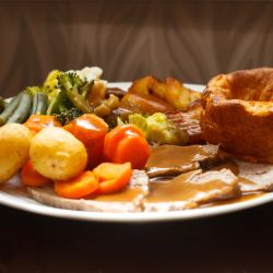 Roast dinner at lunch club for elderly