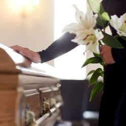 A mourner at their elderly relative's funeral in Suffolk after someone dies