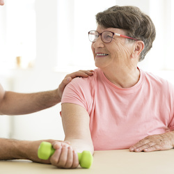 Woman undergoing stroke exercise rehabilitation because of Suffolk Stroke Support Services