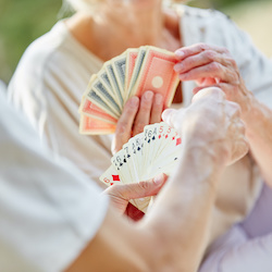 Elderly people playing cards at a Day Care Centre in Cambridgeshire