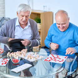 Elderly people enjoy playing games in respite care in Kent