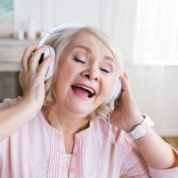 Woman enjoying Hertfordshire musical memories dementia singing