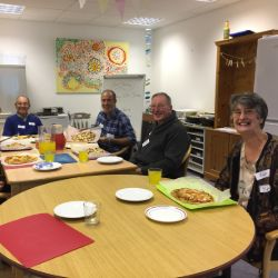 Cogs club members in Kent who have made their own pizza.